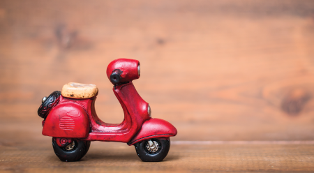 toy vespa with rustic look on wood
